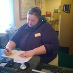 Carolyn helping a guest