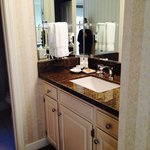 Granite counter top and wrap around mirrors