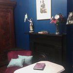 LOVE the blue walls in the sitting area of the French room