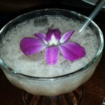 drink with orchid in large desert glass