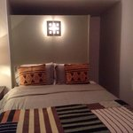 The bedroom area of Mimi's Bungalow. Spacious walk-in closet behind the bed. Flat-screen tv in r