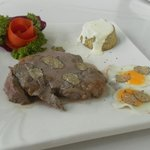 tenderloin USA, cabbage pie with goat cheese cream and 2 quail eggs with truffles