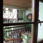 Вид из нашего окна на нашу терраску со столом.