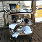 Breakfast trolley on the deck of the Garden Suite