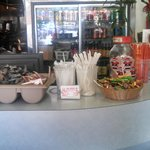 Condiments, Candy, Chopsticks and other related items on counter for takeout