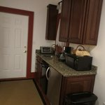 Kitchenette with granite counters and nice appliances.