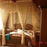 angels room, balcony, couches, 32 inch tv, bath, shower, minibar etc