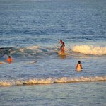 young children braving the waves