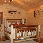 Queen lodge bed in our private 2 person cabin w/ fp, kitchenette and bath.