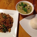 Pad Kee Mao & Green Curry with chicken.  Curry comes with a scoop of rice.  You will probably ne