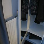 wardrpobe door meets radiator
