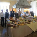 Some of the staff with breakfast