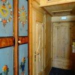 Cupboard doors on left, entry in front