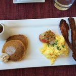 pumpkin pancakes with orange cinnamon butter, eggs, roasted tomato and bacon