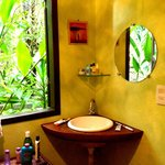 Bathroom - with view of the lush greenery that surrounds the pousada.