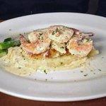 Artichoke Spinach Stuffed Halibut, crab, gulf prawns, mashed potatoes, creamy garlic sauce