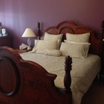 Nice large bedroom with table, chairs and tea/coffee facilities and fridge