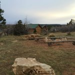 Community firepits between some of the cabins