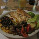 Hog Fish Meal with rice, beans, and veggies sides