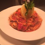 Baby octopus, baby squid and king prawn tagliatelle bound in a tomato and chill sauce...... Mmmm