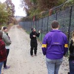 Our guide for the walking tour talks about the animals and the work under way at  the refuge.