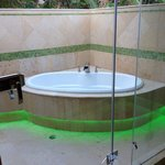 Outdoor soaker tub with cool green lights