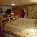 A spacious bedroom with authentic Amish furniture, comfy mattress, plenty of room for luggage an