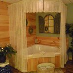 Tucked away in a corner of the master bedroom is this charming jacuzzi tub with all the amenitie