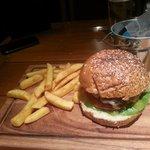 yummy beef burger in pub under hotel