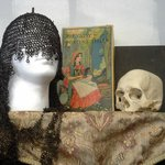 Antique chain mail, games and a skull