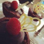Raspberry curd and dark chocolate ganache tarts