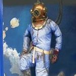 Our life sized diver in our entrance window.