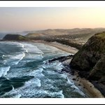 """""""Sundowners"""" from atop the craggy-rocked coastline, view at Coffee Bay"""