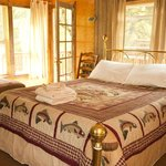 Solitude - A river view suite that includes two queen beds, private bath and deck.