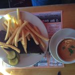 Grilled cheese on pumpernickel, fries and cup of homemade tomato soup