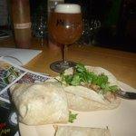 Carnitas taco and half a burrito