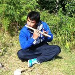 Multi-talented guide, Manoj, playing the flute during a break on the trek