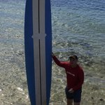 Posing with my long surf board after training
