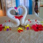 Beautiful flower arrangement on bed