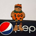 This Halloween bear was atop a soft-drink machine.