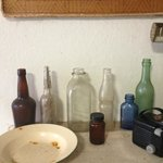 Collection of bottles.Look the old milk bottle at center