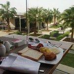 Having breakfast looking at the pool