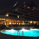 Night view of the pool and restaurant area.