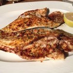 Sea Bream baked with garlic, parsley and lemon juice