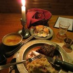 yummy food, served on pewter, with candlelight