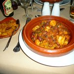 Spiced bean tagine on bed of rise with curried potatoes