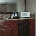 Kitchenette in room. Fridge, coffee, sink, microwave