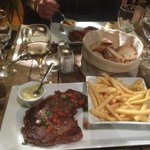 Steak and french fries, duck with orange sauce