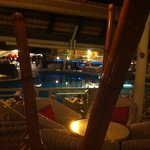 View of pool from bar at night