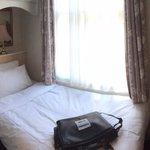 Tiny room, but comfy bed.